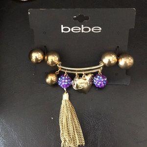 New bebe Gold, purple balls & tassel bracelet